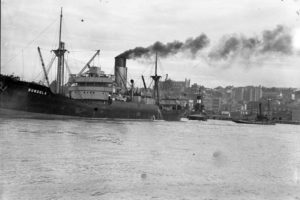 Ship Dundula grounded on a mudbank in Newcastle Harbour, NSW, March 17, 1936.