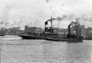 Tugs strive to free ship Dundula grounded on a mudbank in Newcastle Harbour, NSW, March 17, 1936. (3)