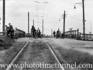 Cyclists crossing the Port Waratah tramline, Newcastle, NSW, November 18, 1938. (3)