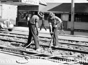 Men with jackhammers working on tramlines in Brunker Road, Adamstown, Newcastle, NSW, August 30, 1938.