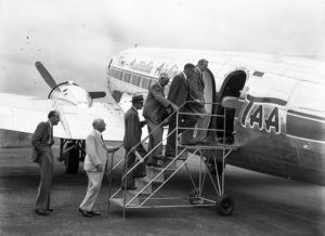 Passengers on the steps of TAA Douglas DC3 in first commercial flight to Williamtown Airport, Newcastle, February 20, 1948.
