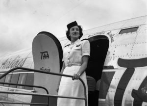 Hostess on the steps of TAA Douglas DC3 in first commercial flight to Williamtown Airport, Newcastle, February 20, 1948.