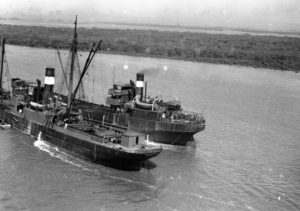 Coal ships stuck on a mud bank in the Hunter River, Newcastle, September 17, 1946.