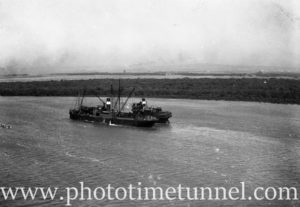 Coal ships stuck on mudbank in the Hunter River, September 17, 1946. (2)