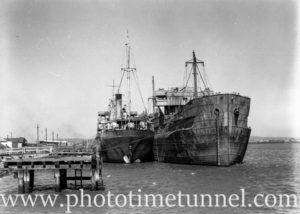 Derelict ships Mokatam and Omaha at Stockton, Newcastle, NSW, March 27, 1946.