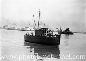 Boat for UNRRA (United Nations Relief and Rehabilitation Administration) in Newcastle Harbour, NSW, February 11, 1946.