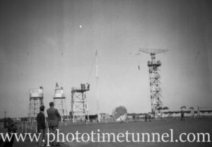 Parachute towers at an air show at RAAF Williamtown fighter base, near Newcastle, NSW, in the early 1960s.