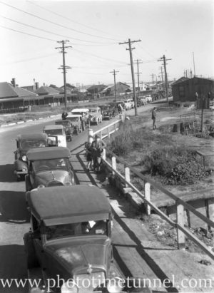 Cars queuing in Newcastle for the punt to Stockton, circa 1940s.