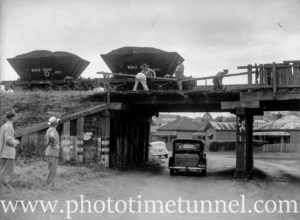 An accident involving coal wagons on the rail bridge at Howe Street, Lambton, NSW, circa 1946. (1)