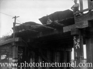 An accident involving coal wagons on the rail bridge at Howe Street, Lambton, NSW, circa 1946. (2)