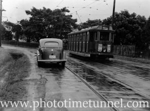 Tram and car at Howe Street, Lambton, near Lambton Park, Newcastle, NSW, 1938.