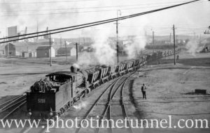 Locomotive 5201 hauling coal wagons at Newcastle, NSW, July 26, 1937.