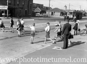 Children crossing Tudor Street Hamilton, Newcastle, NSW, March 28, 1939.