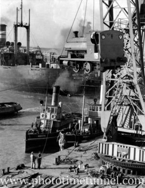 Stewarts and Lloyds Corby railway engine being delivered in Newcastle Harbour, NSW, June 28, 1951. (181)