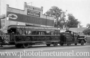 """Trackless train"" owned by MGM movie studio outside J.A. Goldthorpe's Auburn Garage, Sydney, circa 1928."