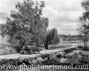 Car on river crossing in rural NSW. Circa 1960.