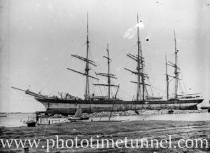 Sailing ship at the ballast ground, Newcastle Harbour, NSW. Circa 1910.