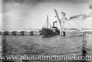 Vessel passing through the bridge at Swansea (NSW). Circa 1930.