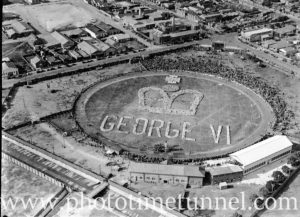 Schoolchildren form a pattern at Newcastle's Number 1 sportsground in honour of newly crowned King George VI. 1937.