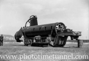 Part of Japanese mini-submarine on low-loader for inspection at Newcastle, NSW, September 3, 1942.