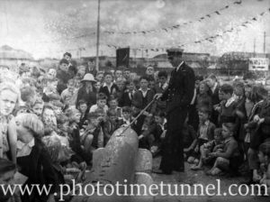 Naval officer describes aspects of the Japanese mini-submarine to schoolchildren in Newcastle, NSW, October 5, 1942. (2)