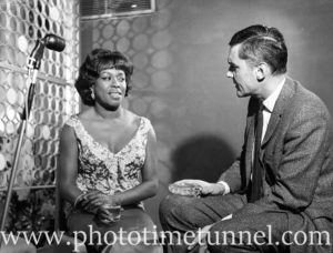 American singer Sarah Vaughan being interviewed by Australian broadcaster Ray Taylor at Chequers nightclub, Sydney, May 18, 1965.