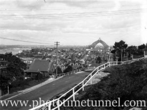 Sydney, NSW, with harbour bridge in final stages of construction. Circa 1932.