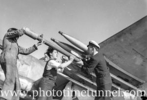 Arming Fairey Firefly aircraft aboard carrier HMS Glory, off Newcastle, NSW, 1946. (1)