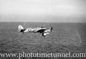 Fairey Firefly aircraft landing on carrier HMS Glory off Newcastle, NSW, 1946. (3)