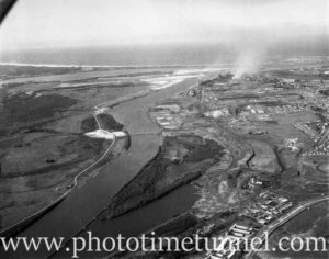 BHP Newcastle steelworks and the Hunter River estuary, showing the filling of Platts Channel and loss of Spit Island in the foreground. The Tourle Street bridge can be seen in the middle ground.