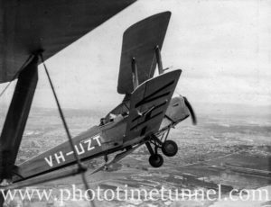 Tiger Moth aircraft over Newcastle, NSW, circa 1940s, showing BHP steelworks.