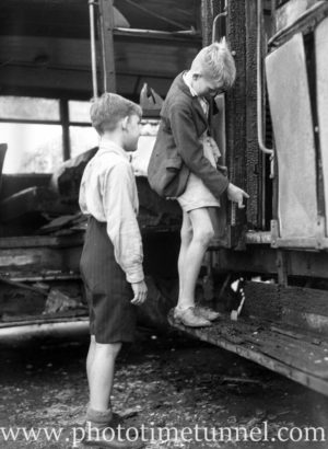 Boys view the aftermath of a collision between a tram and a bus on Turton Road, Waratah (Newcastle, NSW) on February 12, 1944 (3)