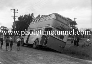 Double-decker bus off the road at Swansea, Newcastle, NSW, February 18, 1948.