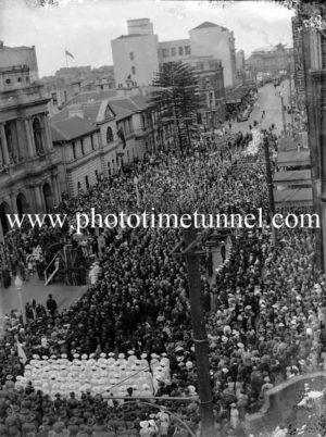 Anzac Day or similar gathering in Hunter Street, Newcastle, NSW. Circa 1940s.