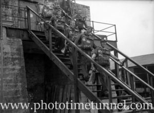 Mines rescue team leaving fire-damaged Aberdare Central pit near Kitchener, in the Hunter Valley, NSW, during attempts to reopen the mine, July 1, 1944. (10)