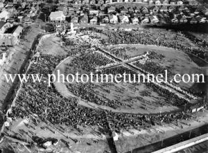 Aerial view of Catholic Church members assembled at the sports ground, Newcastle, NSW, during the 1938 Eucharistic Congress.