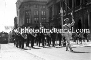 Brass band marching in Hunter Street, Newcastle, NSW on November 28, 1937.