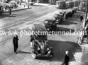 Funeral procession in Hunter Street Newcastle, NSW, near the Merewether Street intersection, February 14, 1946.
