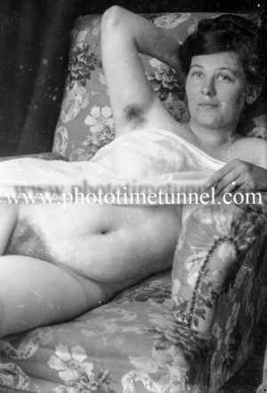 Vintage nude study of a woman on an armchair.