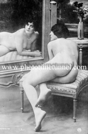 Vintage French postcard study of nude in front of a mirror.