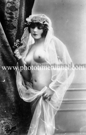 Vintage French postcard study of nude woman draped in sheer veil.