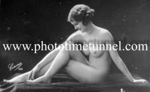 Vintage French postcard study of seated nude woman.