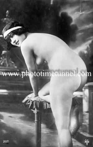 Vintage French postcard study of nude woman with headband.