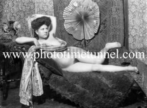Vintage nude study of reclining woman draped in a scarf.