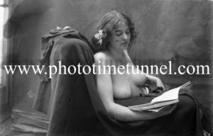 Vintage nude study of woman with a book.