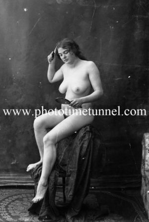 Vintage nude study of young woman with brush and mirror. (2)