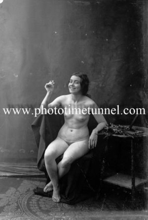 Vintage nude study of young woman with cigarette.