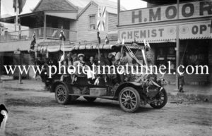 Decorated charabanc in patriotic parade at Raymond Terrace, NSW, circa 1915.