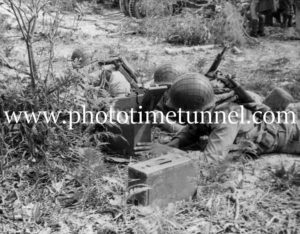 US troops training with a machine gun at Port Stephens, NSW during World War 2.