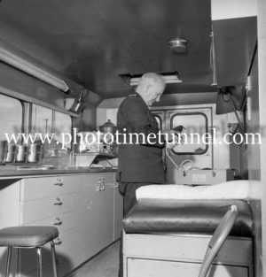 Bert Snow in a waterfront ambulance at Newcastle, NSW, June 7, 1967. (4)